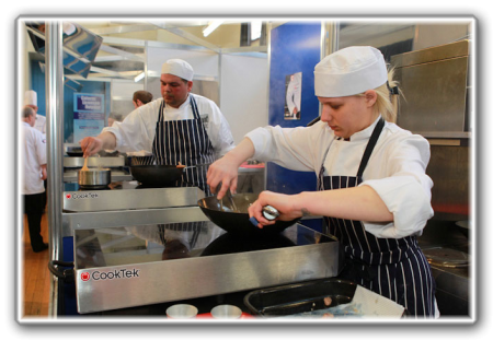 Chef cooking on CookTek twin induction hob with wok